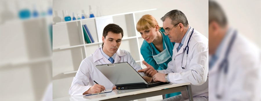 Physicians looking at computer