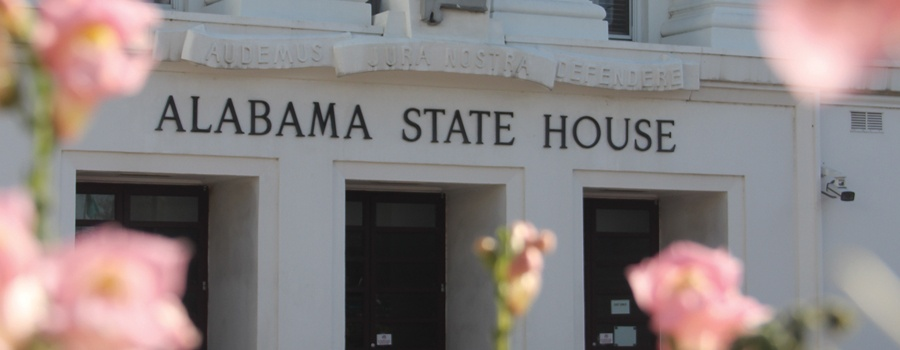 Alabama State House with flowers in front